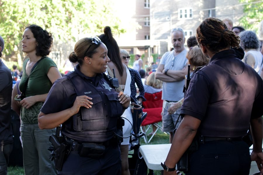Evanston police officer Enjoli Daley speaks to community members. Daley said she had yet to scope out the scene, but looked forward to eating a lobster roll from the Happy Lobster Truck once the line died down.