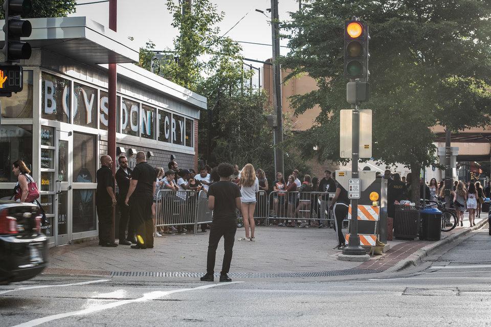 Fans wait in line to grab copies of Frank Ocean's new album,