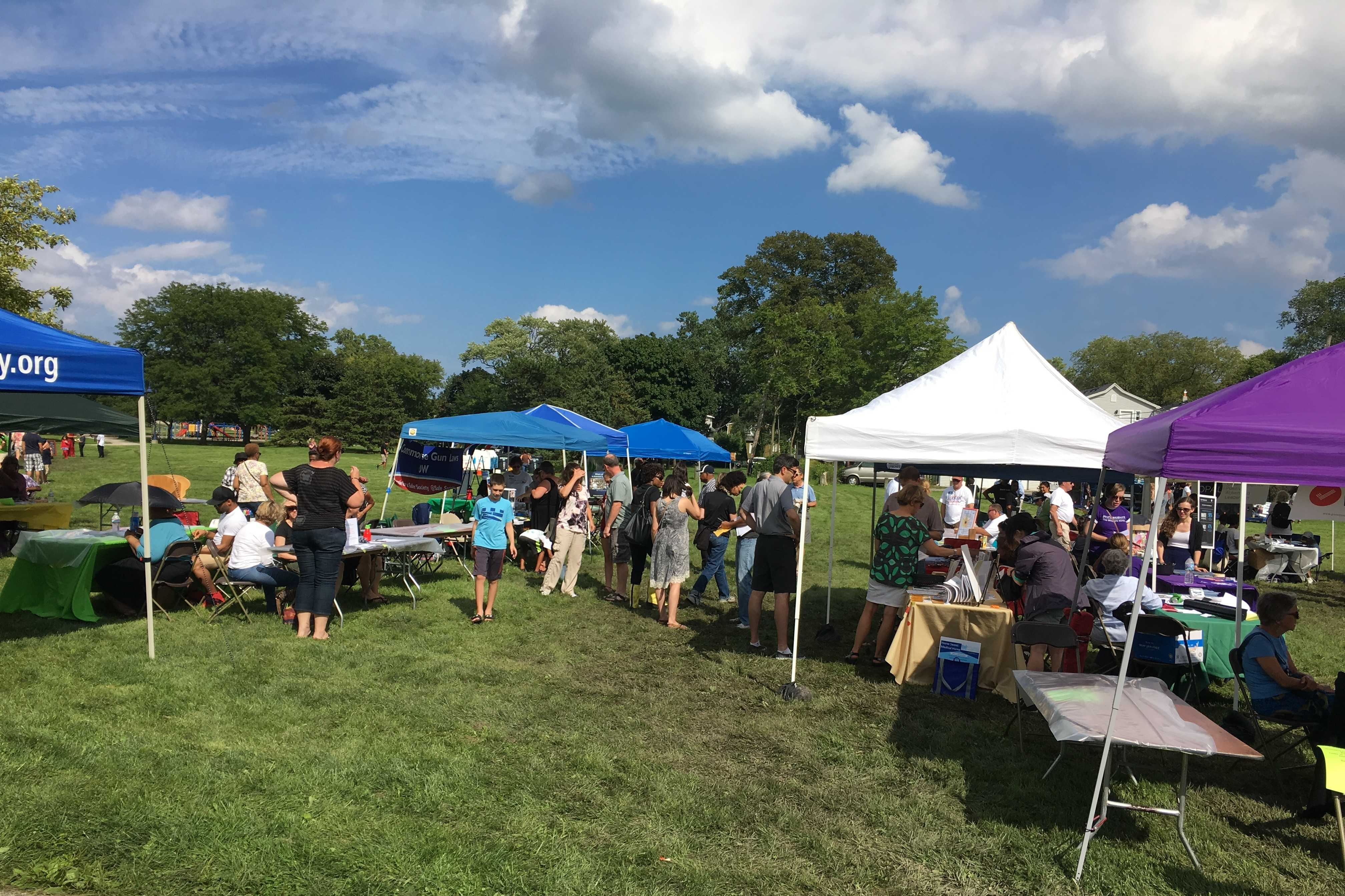 Residents and Community members gather at Twiggs Park for the Fifth Ward Festival. The festival featured information booths in addition to food vendors and entertainment acts to help promote the end of gun violence.