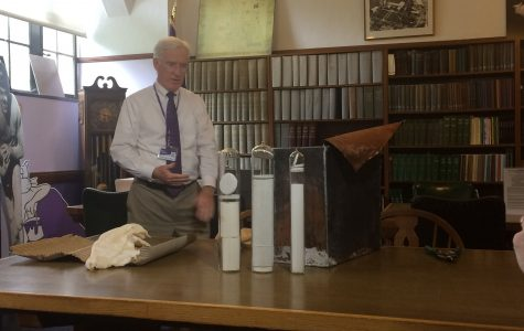 University Archivist Kevin Leonard unveils three glass containers found inside the Kresge Hall time capsule. The documents included a Daily Northwestern article from 1953.