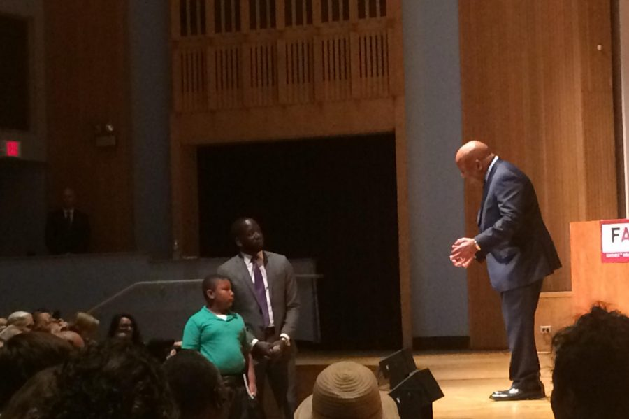 U.S. Rep. John Lewis answers a question from a young audience member during his visit to Evanston Township High School on Monday. Lewis encouraged young students to become activists and speak up against injustice.