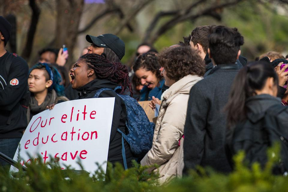 Students gather outside the Black House during a demonstration last Fall. In a report released last week, a University-appointed committee outlined several recommendations to enhance the black student experience at Northwestern.