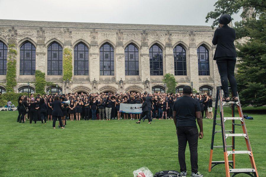 Kellogg students, faculty and administration gather for a group photo to express solidarity with protests against police killings. More than 350 people gathered on Deering Meadow on Friday for the photo.