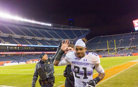 Justin Jackson waves as he jogs off the field. The junior running back is expected to be the main playmaker in Northwestern's offense.