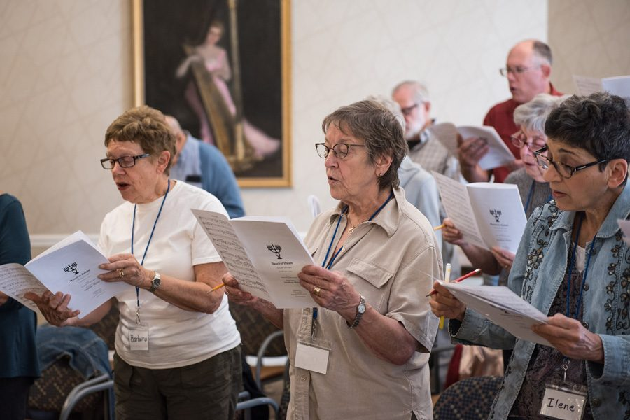 Members of the Evanston Encore Chorale, a choir focused on the city's older adults, rehearse music Monday morning at Three Crowns Park in preparation for their upcoming December concerts.