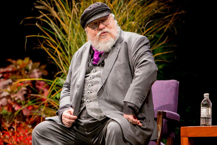 "George R.R. Martin talks with the audience about his fantasy series, ""A Song of Ice and Fire,"" during a Q&A at Cahn Auditorium in November. ""Game of Thrones,"" which is based on his series, won three Emmys on Sunday, bringing the show's total to 38 wins."
