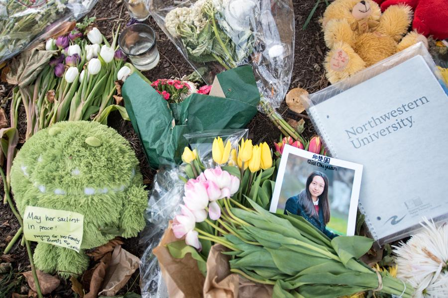 "Students leave flowers, stuffed animals and notes as a memorial for Northwestern student Chuyuan ""Chu"" Qiu who died in a bike accident Thursday. Evanston's first ward alderman called for lower speed limits on Sheridan Road where the accident occurred."