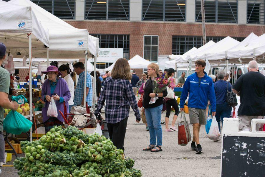 Customers shop around the Downtown Evanston Farmers Market. The market features up to 58 vendors selling fruits, vegetables, cheese and bakery items, and accepts LINK cards for those who qualify for cash assistance or food stamps.