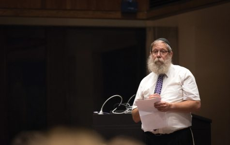 Rabbi Dov Hillel Klein speaks at a memorial for Northwestern student Scott Boorstein. More than 300 people gathered in the Louis Room of Norris University Center on Friday and shared memories of Boorstein.