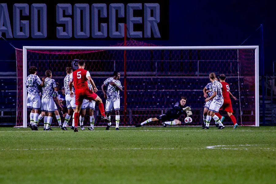 Robbie White dives to his left for the save. The Cats host DePaul on Wednesday.