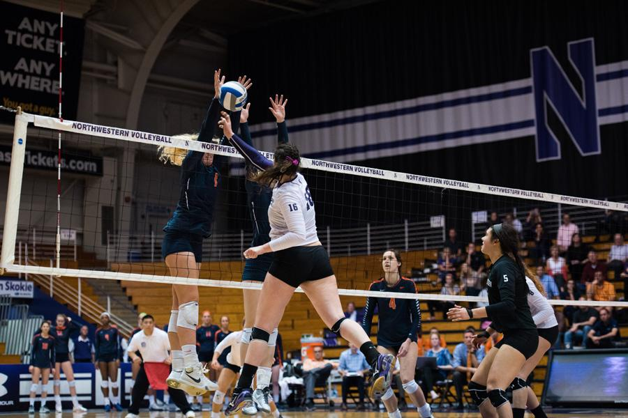 Senior outside hitter Sofia Lavin gets blocked at the net. Northwestern hit well in its game against Indiana but struggled with serving in the four-set defeat.