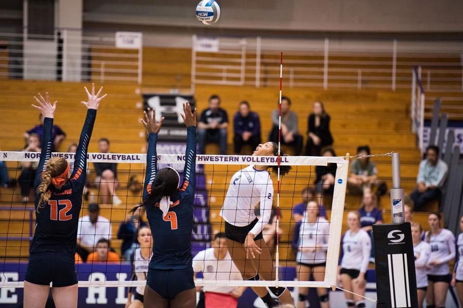 Symone Abbott prepares for a spike. The junior finished with 46 kills over the course of the UNI Tournament this weekend.