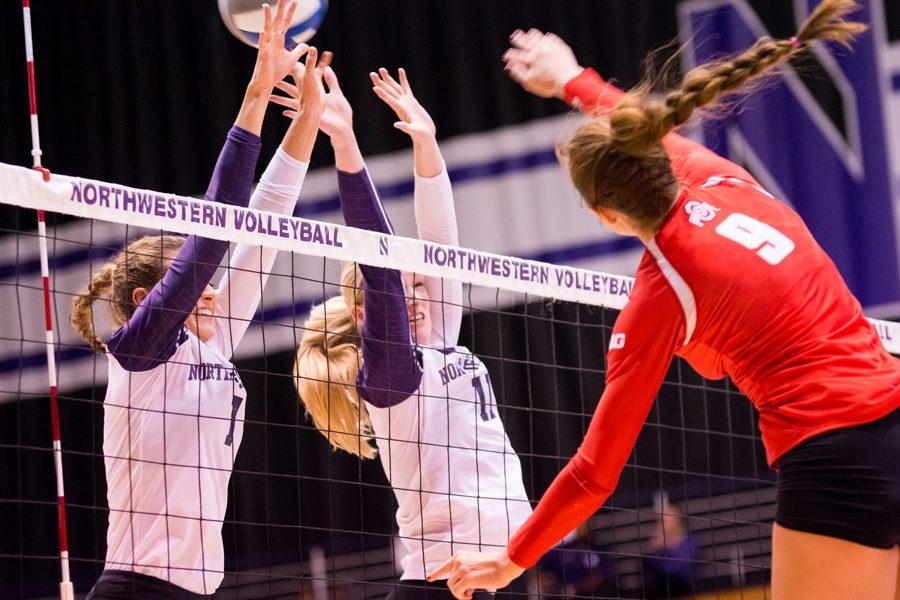 A pair of Wildcats leap for a block. Northwestern dropped to 0-3 in Big Ten play after a straight-set road loss to No. 19 Ohio State.