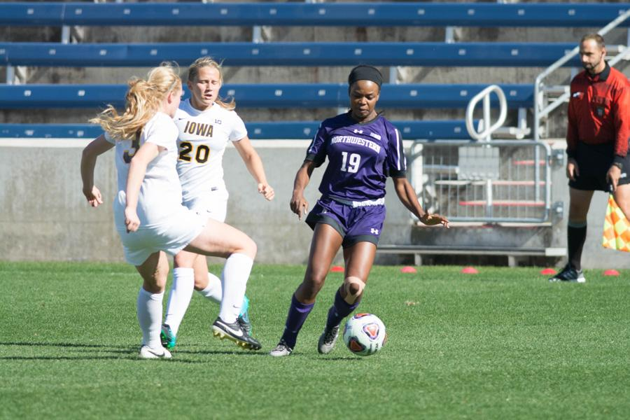 Kourtney Scott avoids a defender. The senior defender and the Wildcats hit the road this weekend in search of a signature win after a 9-0-0 start to the season.