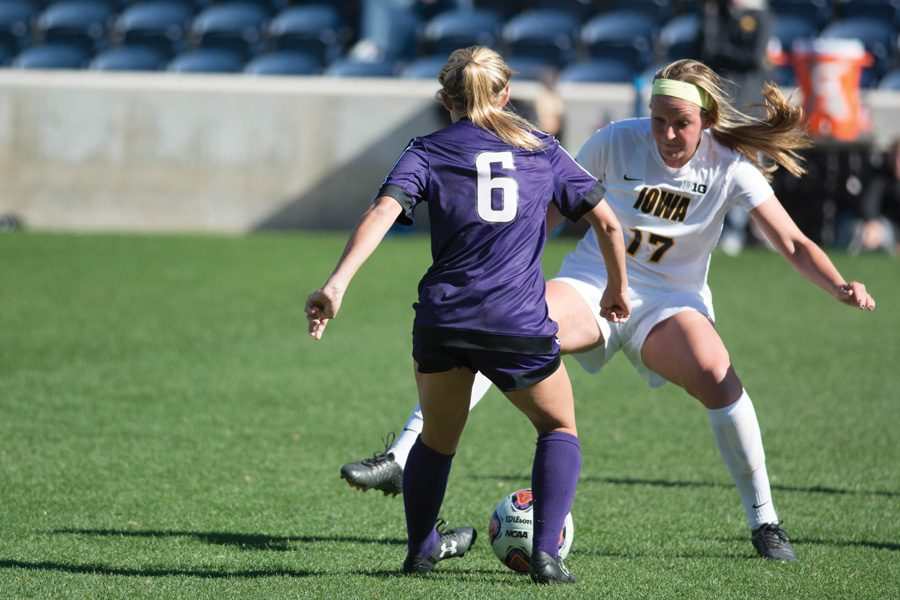 Kassidy Gorman faces off with a defender. The junior midfielder will look to help Northwestern's stout defense hold off Ohio State's talented forward corps on Saturday.