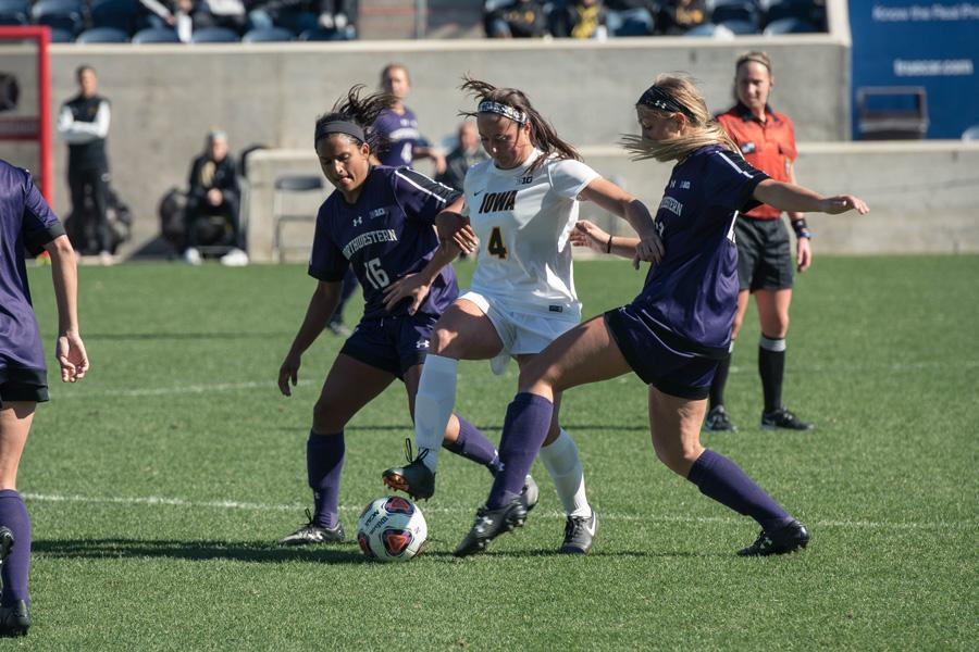 Nandi Mehta fights for possession. The fifth-year senior midfielder notched Northwestern's second goal in the win over Purdue.