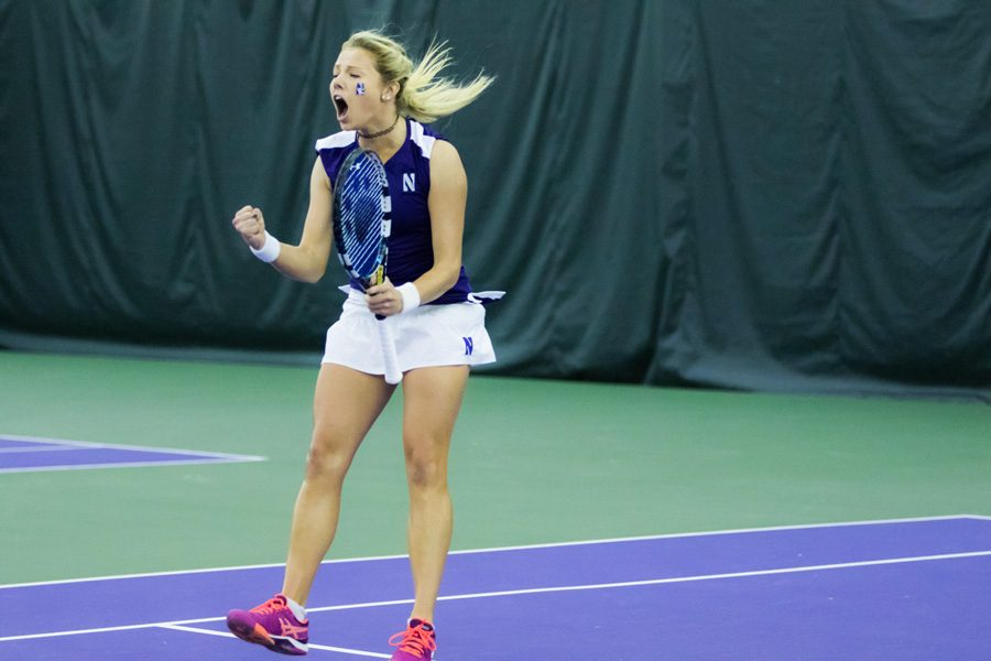 Junior Alex Chatt celebrates after winning a match. Chatt and junior Maddie Lipp enter the fall season ranked No. 8 in doubles.