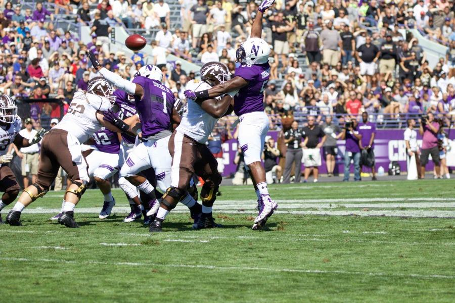 Xavier Washington tries to swat a pass. The junior defensive end has had five tackles through Northwestern's first two games.