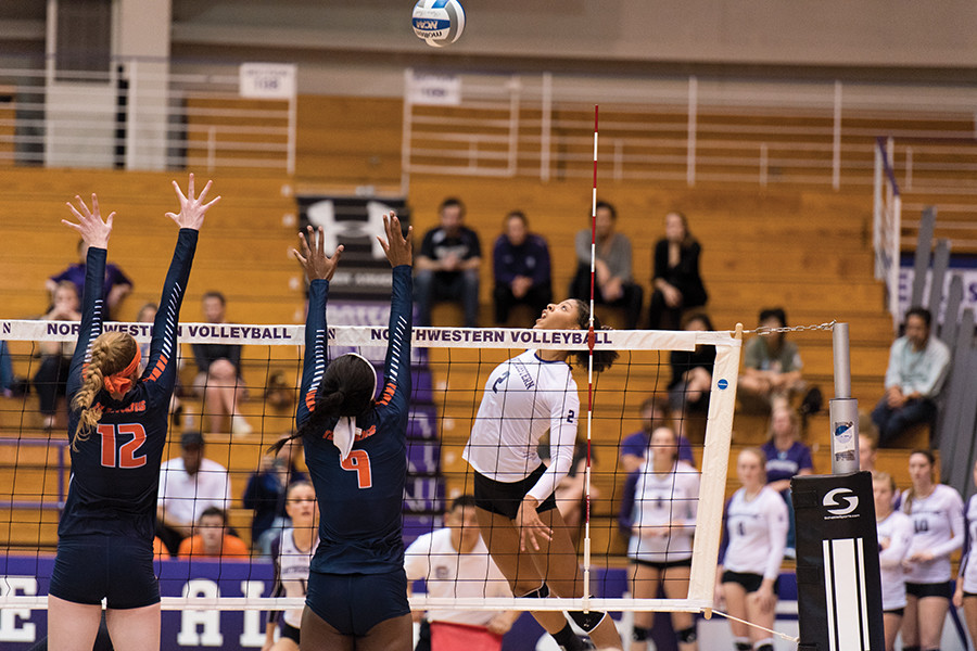 Symone Abbott readies to spike the ball. The junior helped lead a strong Northwestern offense over the weekend as the Wildcats dropped a single set over three games.
