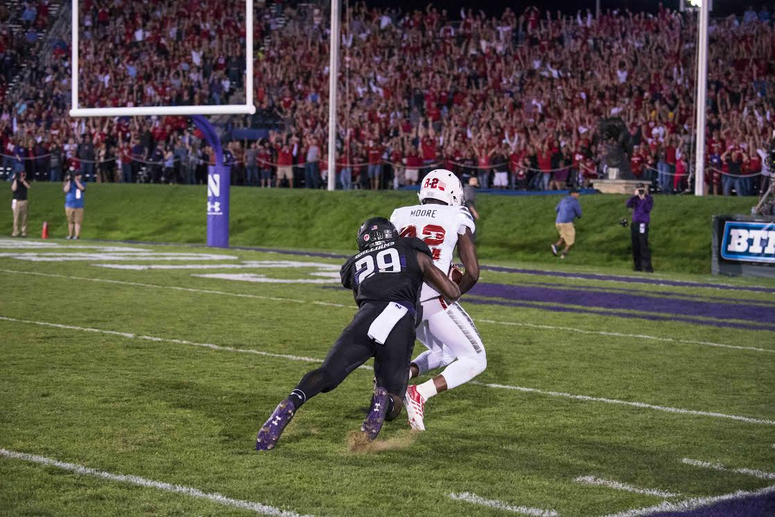 Trae Williams tackles Nebraska receiver Alonzo Moore moments after he caught a 59-yard pass. Northwestern gave up 556 yards of total offense Saturday.