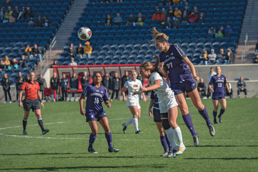 Kayla+Sharples+skies+for+a+header.+The+sophomore+defender+helped+Northwestern+earn+two+shutout+victories+over+the+weekend.