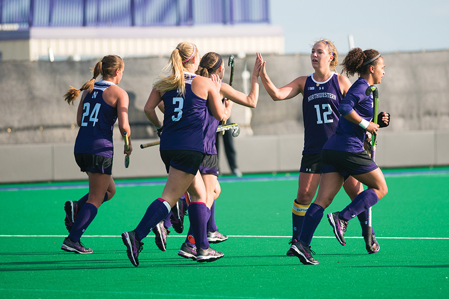 A group of Wildcats celebrate. Northwestern earned a late upset against No. 8 Boston College on Friday but failed to edge No. 4 Duke on Sunday.