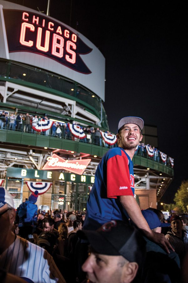 A Cubs fan smiles outside Wrigley Field after the Chicago Cubs defeat the Los Angeles Dodgers on Saturday night. The team won 5-0 in Game 6, making it to their first World Series in 71 years.
