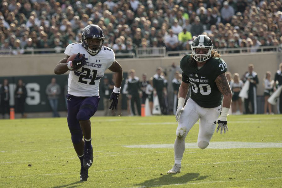 Justin Jackson carries the ball in the first half against Michigan State Saturday. The junior ran for 188 yards and two touchdowns.