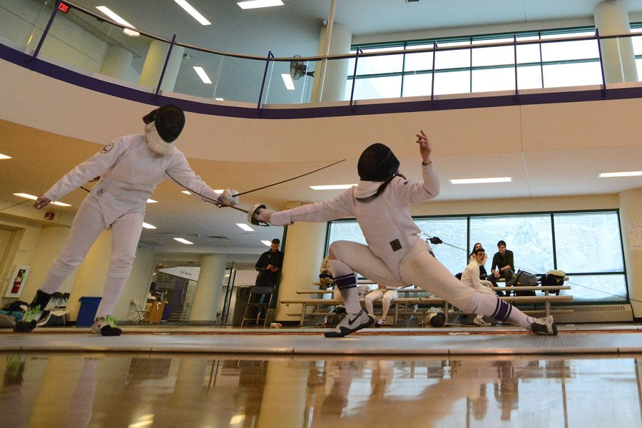 A+Northwestern+fencer+lunges+to+score+a+touch.+The+Wildcats+put+together+a+strong+showing+at+the+Remenyik+Open%2C+their+first+tournament+under+coach+Zach+Moss.