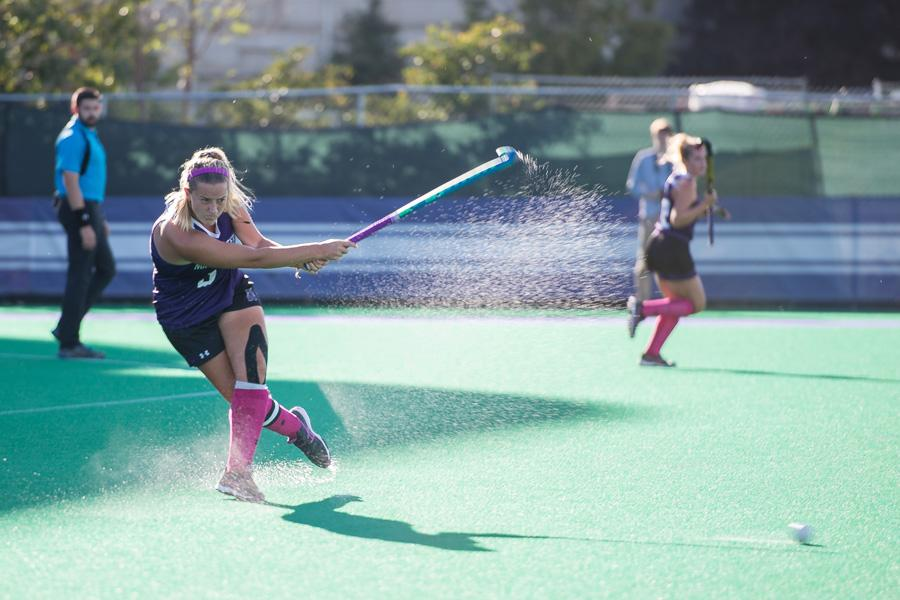 Dominique Masters fires a pass. The senior midfielder had a shot on goal as Northwestern struggled to finish its chances in an overtime loss to No. 16 Iowa on Friday.