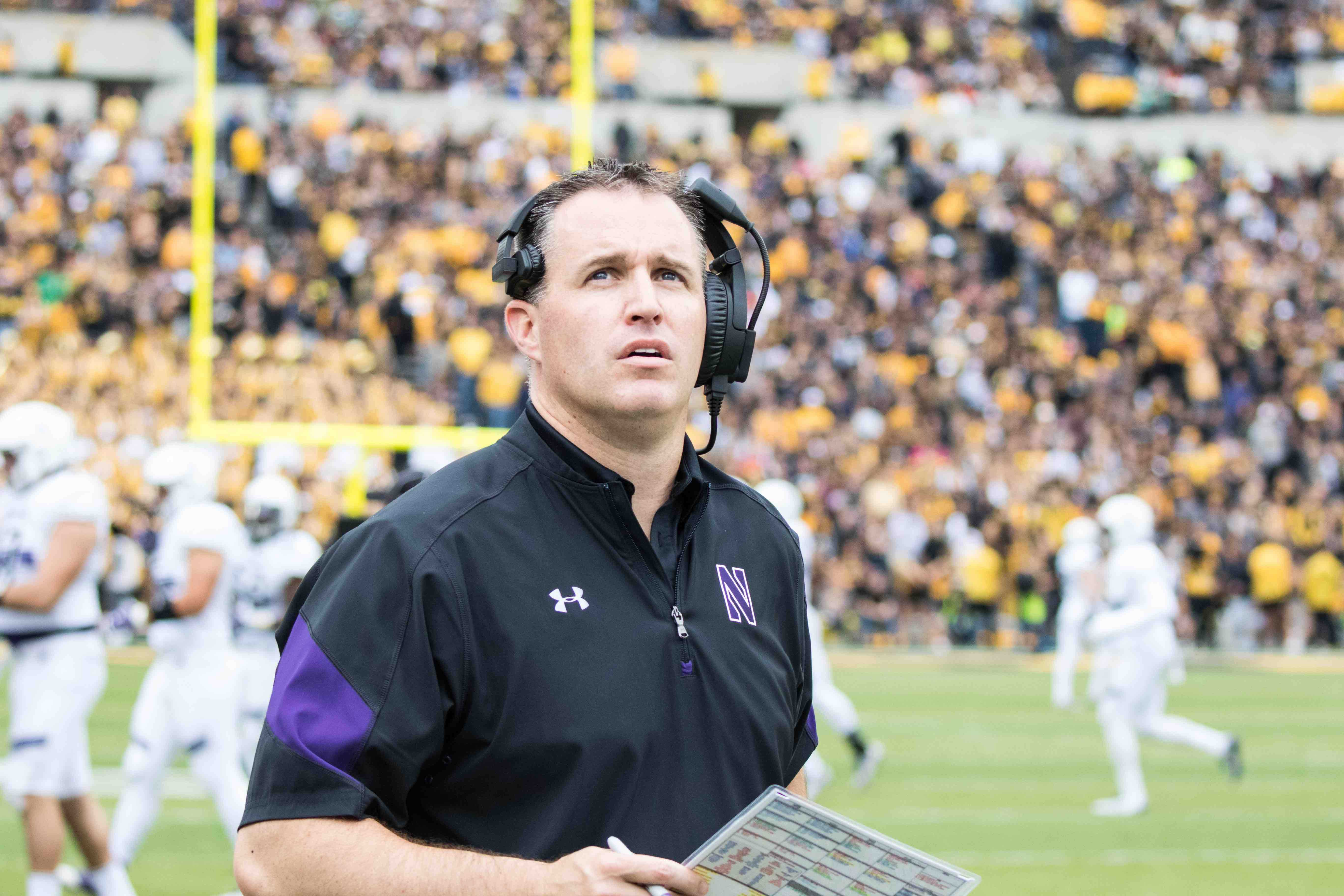 Coach Pat Fitzgerald looks up during Northwestern's Oct. 1 game at Iowa. The team's football handbook rules were previously