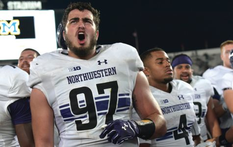 Joe Gaziano sings the fight song after Northwestern's win over Michigan State. The redshirt-freshman's sack and fumble recovery helped shift momentum in the Wildcats' victory.