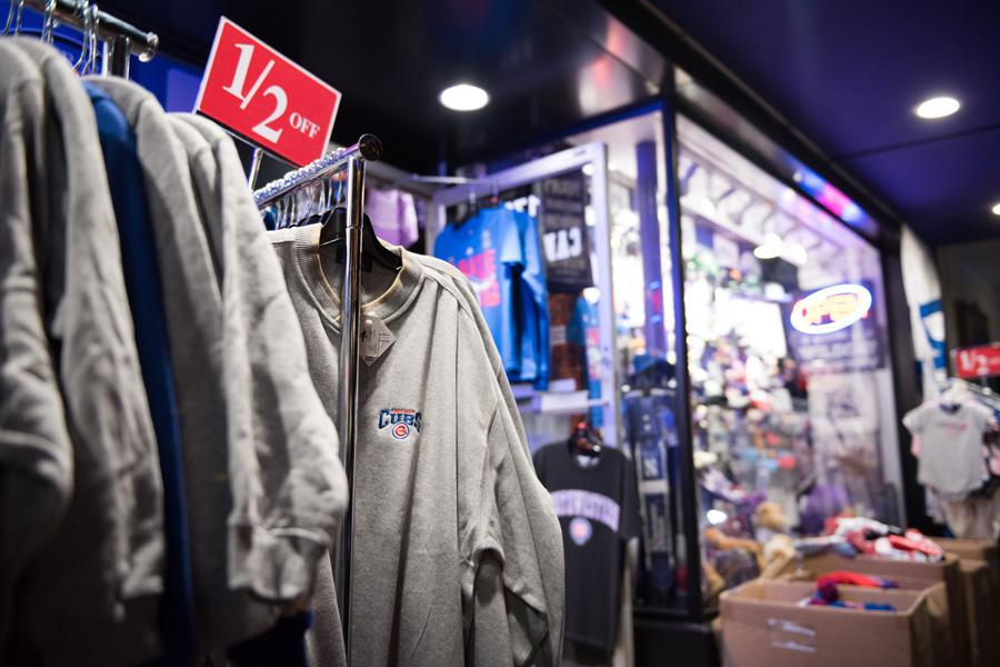 Cubs merchandise hangs in a store. Evanston stores are stocking up on Cubs merchandise as the team makes its World Series run.