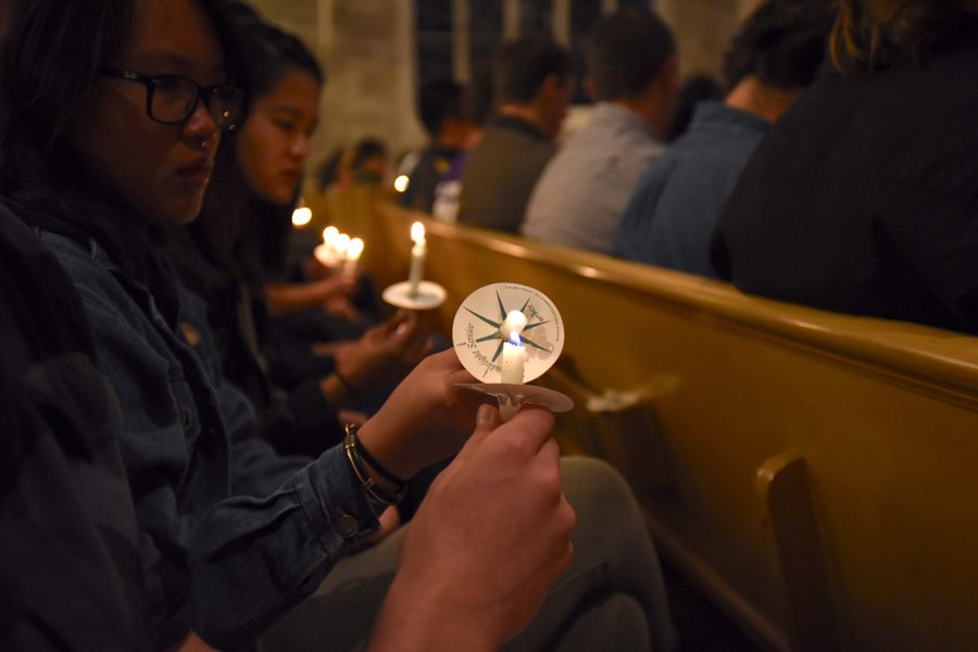 Students light candles during a memorial for Chuyuan Qiu on Friday evening. More than 650 people filled Alice Millar Chapel for the service and remembered Qiu for her excitement to be attending Northwestern and her lighthearted attitude.