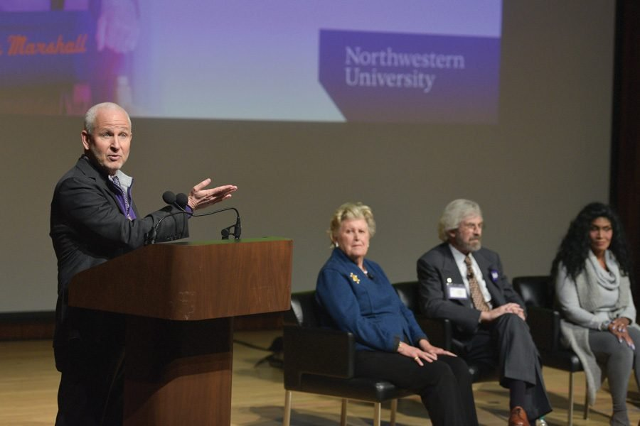 University+President+Morton+Schapiro+speaks+at+a+panel+Friday.+Five+Northwestern+alumni+spoke+at+the+panel%2C+and+some+of+them+discussed+progress+in+racial+and+gender+equality+at+the+University.