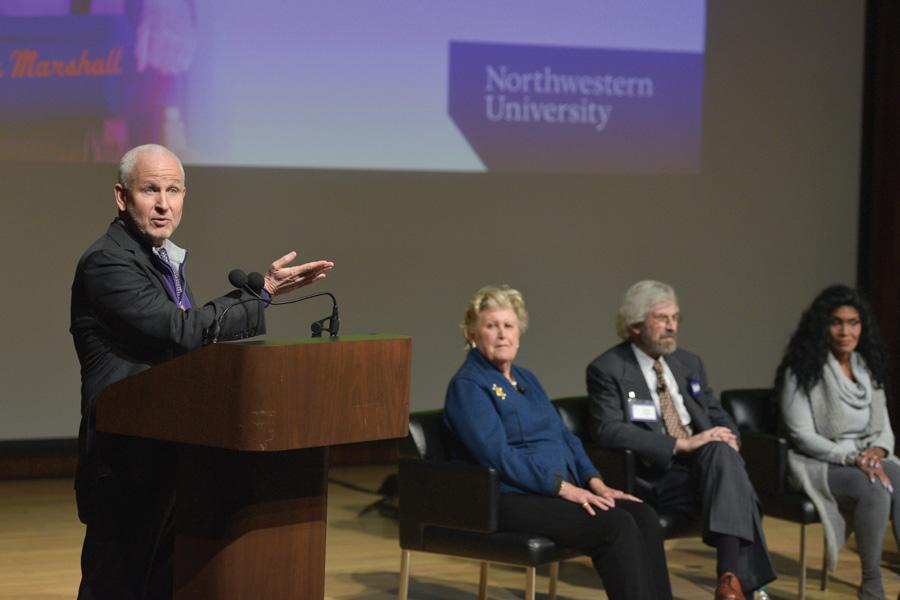 University President Morton Schapiro speaks at a panel Friday. Five Northwestern alumni spoke at the panel, and some of them discussed progress in racial and gender equality at the University.