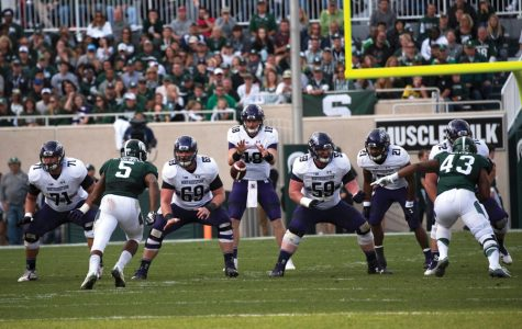 Football: After early-season struggles, offensive line slowly improving