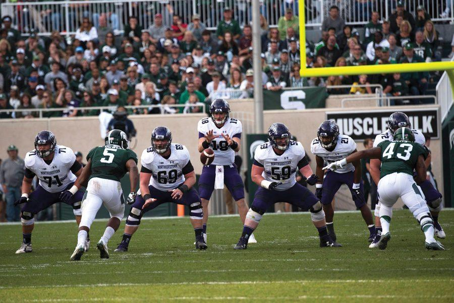 Northwestern snaps the ball to quarterback Clayton Thorson. The offensive line has allowed just two sacks over its past two games.