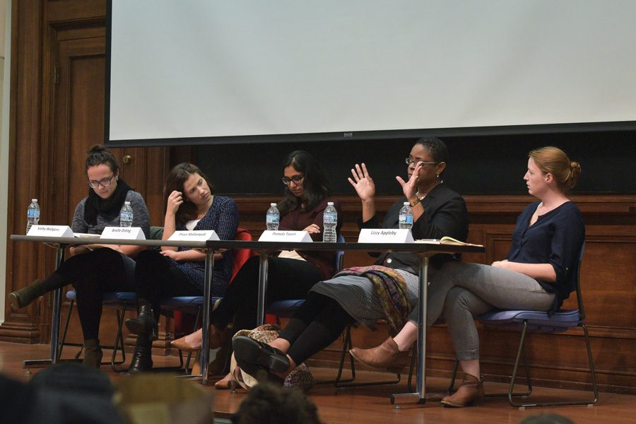 Panelists+speak+about+class%2C+race+and+identity+in+reproductive+justice.+The+panel+was+hosted+by+iGEM+at+Harris+Hall+on+Thursday+night.