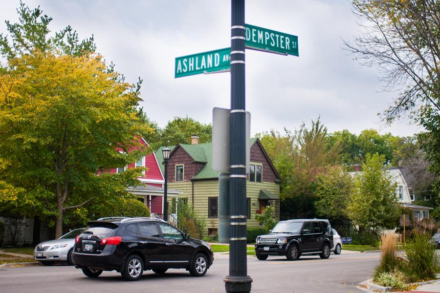 Cars rush past the intersection of Dempster Street and Ashland Avenue. City staff and residents are trying to install a crosswalk at the intersection.