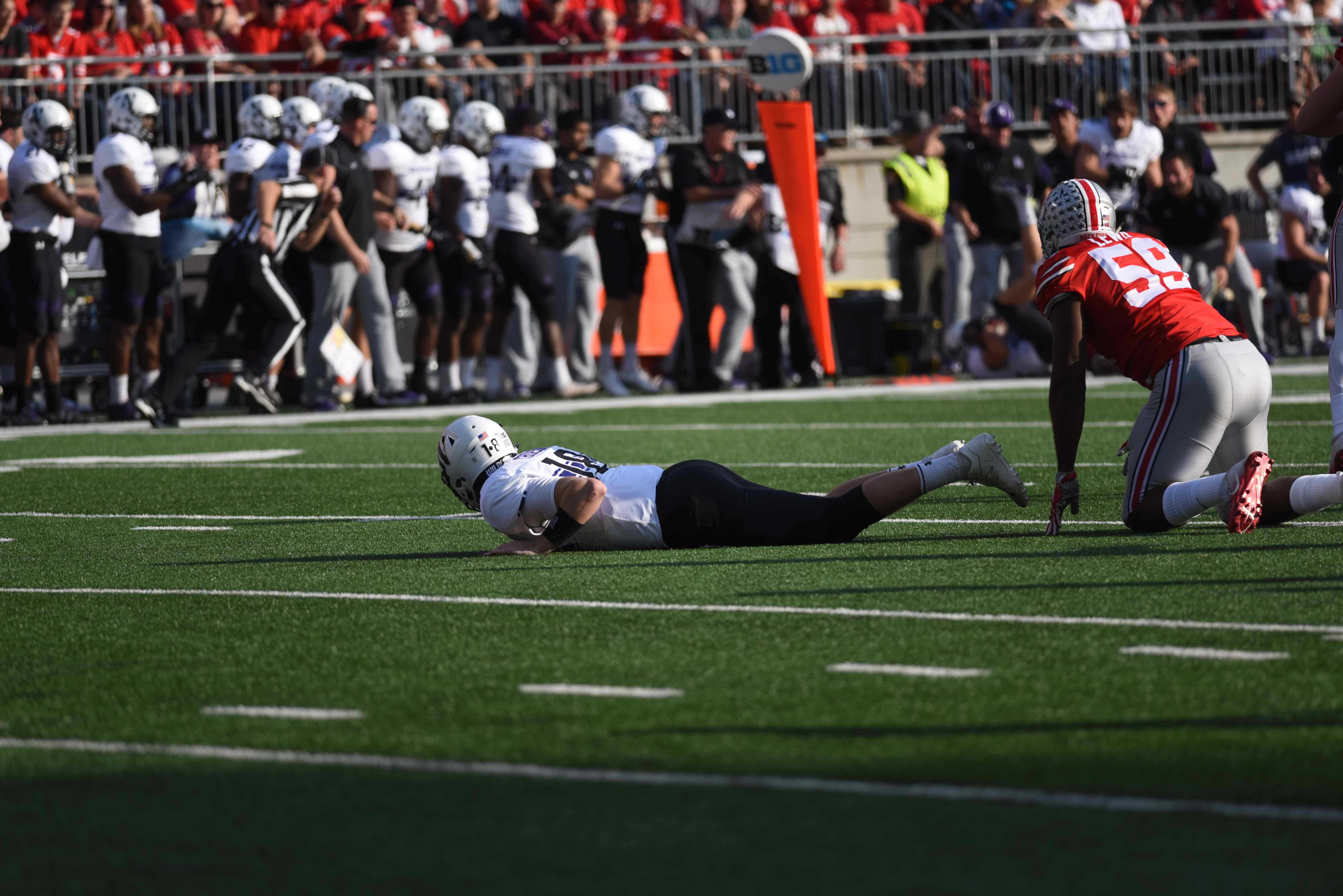 Clayton Thorson watches from the ground. The sophomore led Northwestern to a near-upset of No. 6 Ohio State.