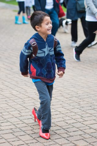 A little boy participates in Walk a Mile in Her Shoes. The event was billed as an opportunity to raise awareness for the dangers of sexual violence against women.