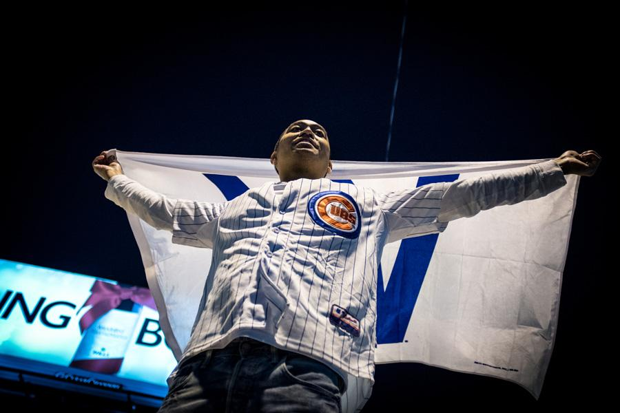 A Chicago Cubs fan celebrates after the Cubs clinched their first World Series berth since 1945. Evanston is planning on setting off the emergency alarms if the team wins the World Series.
