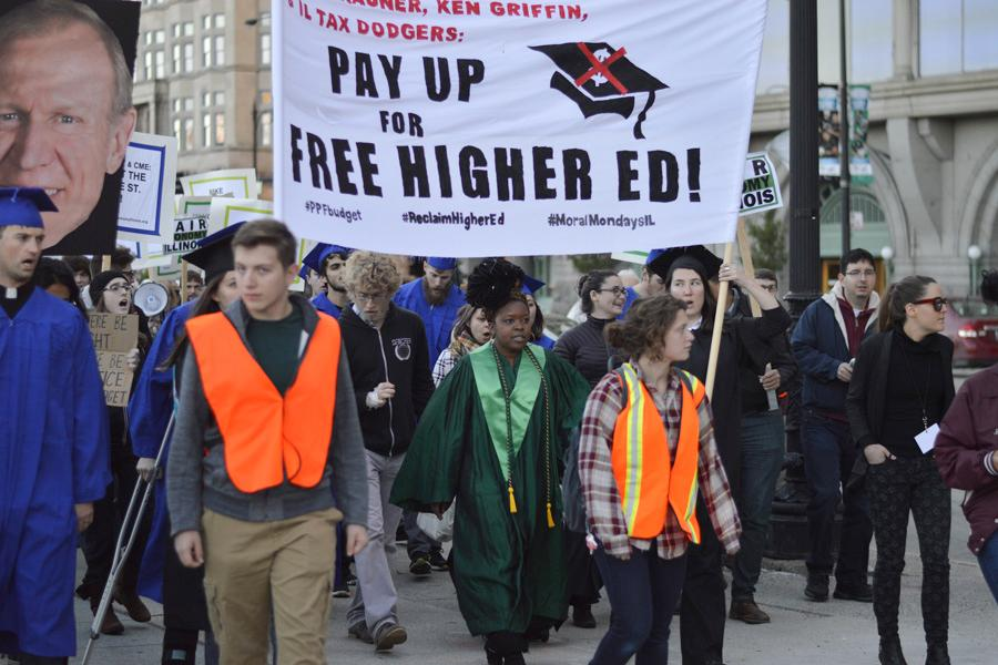 Weinberg senior Jackson Paller (center) helps lead a group of protesters during a demonstration for affordable higher education in Illinois. Hundreds of people gathered for the event, including students from Student Action NU.
