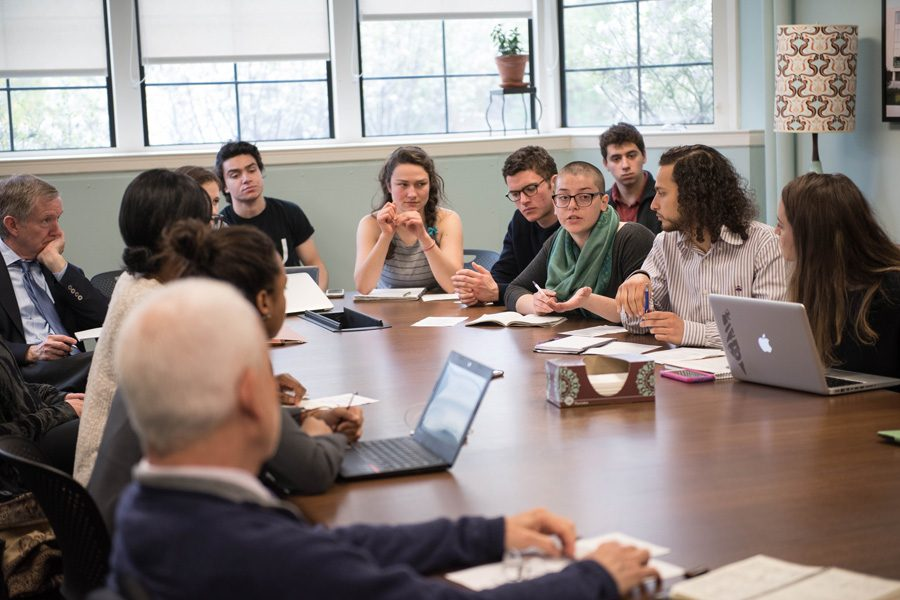 Scott Brown and other student divestment advocates meet with University President Morton Schapiro in April to discuss the socially responsible investment committee. Brown is the co-founder of Student Action NU, a new group focusing on using an intersectional perspective to organize around social justice issues.