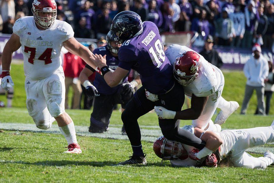 Clayton Thorson gets tackled in the second half. The sophomore quarterback threw for 252 yards in the first half but just 33 in the second half.