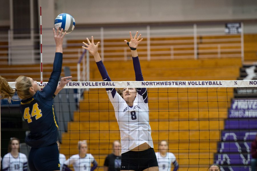 Gabrielle+Hazen+attempts+a+block.+The+junior+middle+blocker+had+three+kills+as+Northwestern+slumped+to+a+sweep+at+the+hands+of+No.+24+Illinois.+