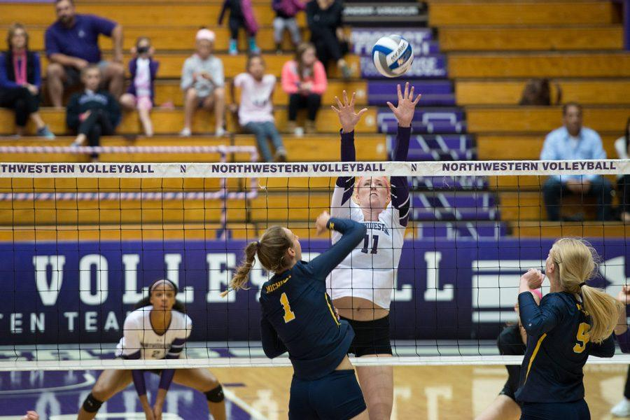 Maddie+Slater+rises+for+a+block.+The+senior+middle+blocker+notched+her+300th+career+block+on+Friday+against+Iowa.