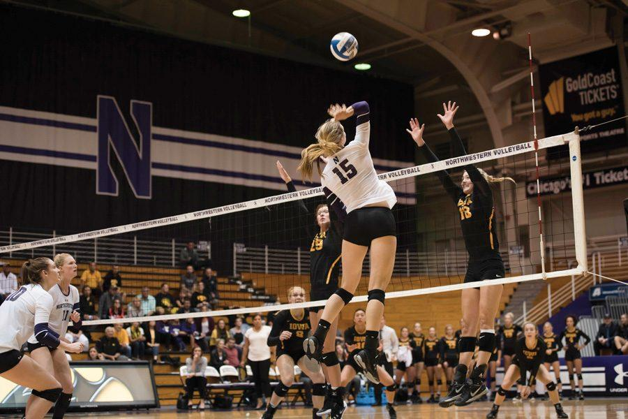 Kayla+Morin+jumps+to+spike+the+ball.+The+senior+had+seven+kills+in+Northwestern%E2%80%99s+three-set+defeat+against+No.+1+Minnesota+on+Sunday.