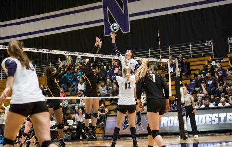 Taylor Tashima reaches for the ball. The junior setter and the Wildcats are still looking for their first Big Ten win this season.
